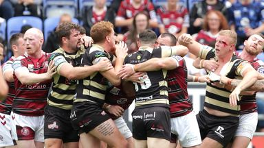 Wigan Warriors and Leigh Centurions players clashed during a fiery Super League encounter at the DW Stadium