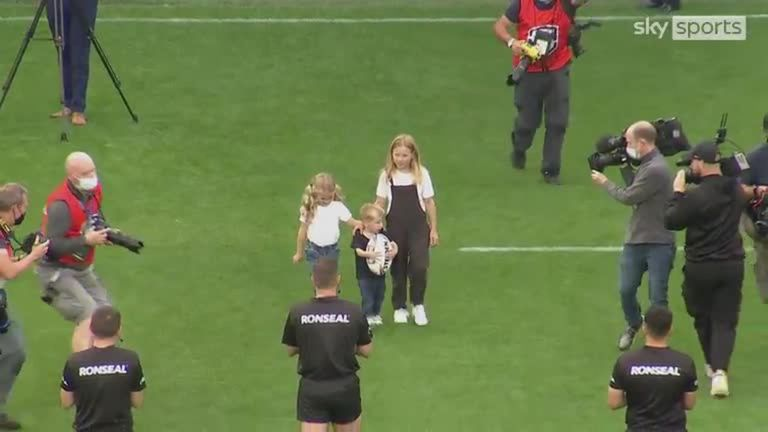 The three children of Leeds Rhinos legend Rob Burrow present the match ball to referee Ben Thaler ahead of the game against Huddersfield at Headingley.