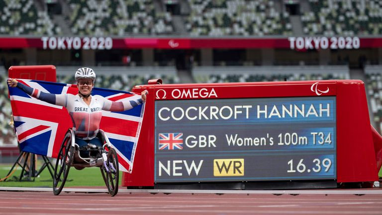 Hannah Cockroft next to her new world record time of 16.39 seconds