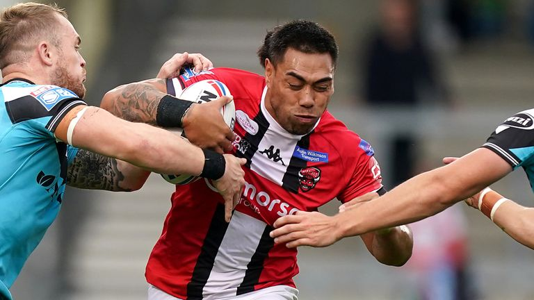 Ken Sio ran in four tries as Salford defeated Hull FC