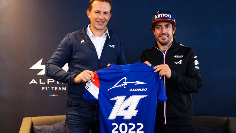Fernando Alonso with Alpine CEO Laurent Rossi (L).