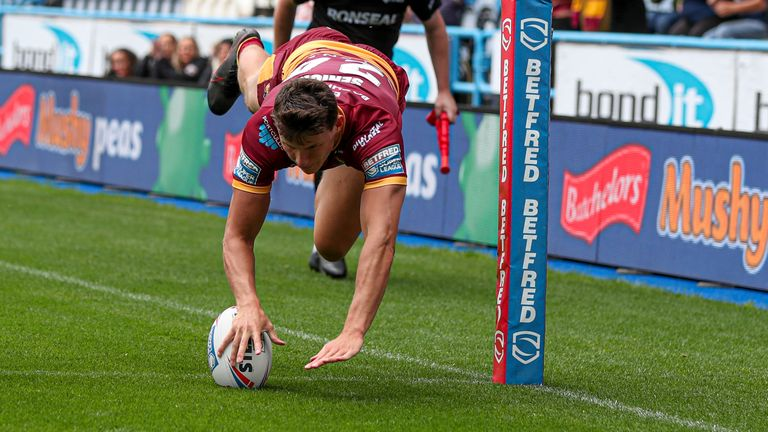 Louis Senior scores a try for Huddersfield