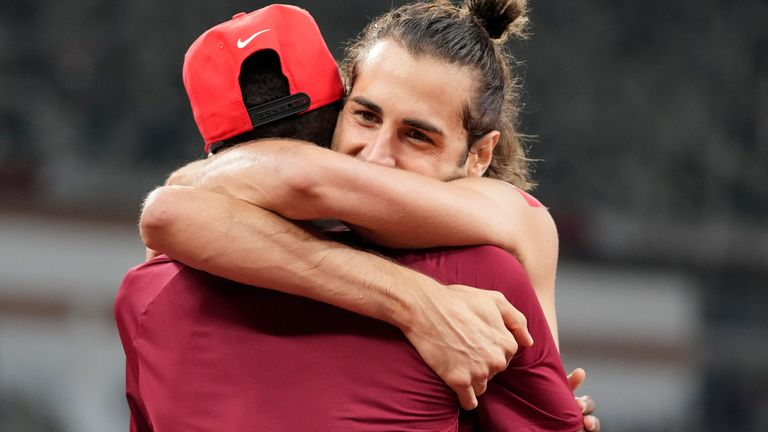 Friends and rivals - Gianmarco Tamberi and Mutaz Essa Barshim share the spoils after a stunning high jump final