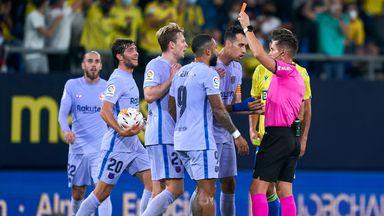 Referee Del Cerro Grande shows Barca's Frenkie De Jong a red card
