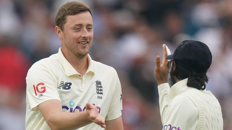 England's Ollie Robinson (L) celebrates a wicket with Haseeb Hameed (PA Images)