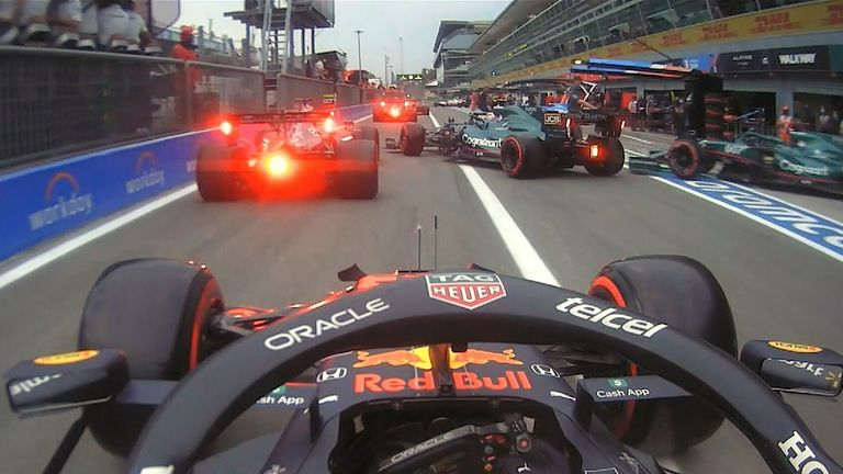 There's almost a pile up in the pitlane as several cars almost collide, while an Alpine mechanic is nearly knocked over!