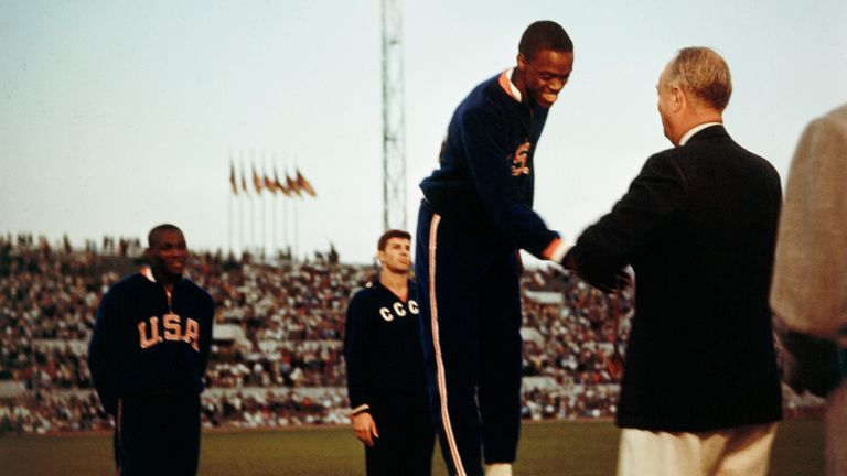 Boston on the podium after winning gold at the 1960 Olympics in Rome