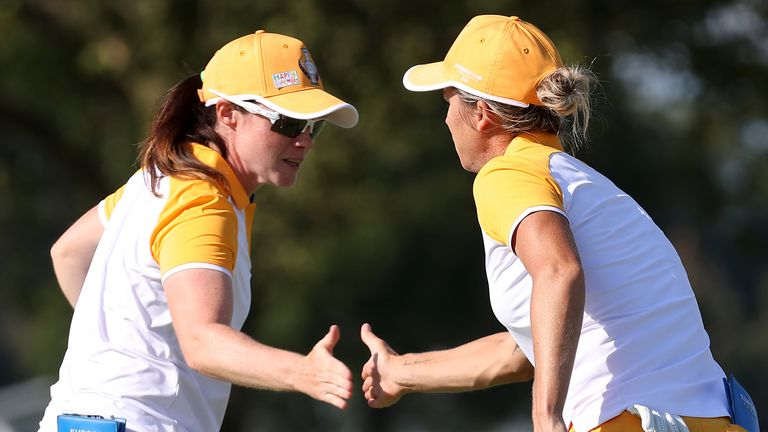 Leona Maguire (left) has won three and halved won of her four matches on her Solheim Cup debut