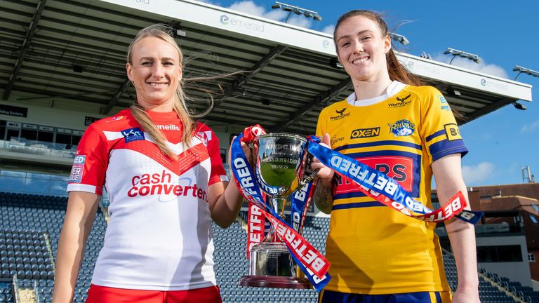 Jodie Cunningham of St Helens and Sophie Nuttall of Leeds pose with the Women's Super League trophy ahead of Sunday's Grand Final