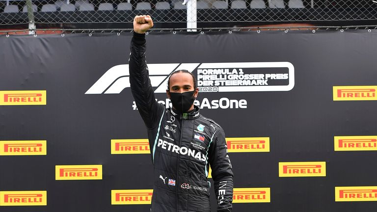 Lewis Hamilton celebrates on the podium with his fist in the air after winning the Styrian Formula One Grand Prix in July 2020