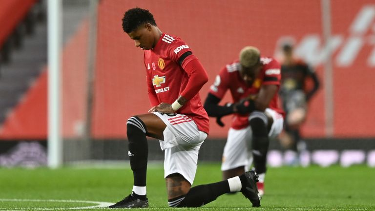 Manchester United's Marcus Rashford takes a knee at Old Trafford last year